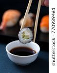 chopstick with sushi roll and... | Shutterstock . vector #770939461