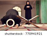 an open holy quran with wood...   Shutterstock . vector #770941921