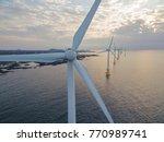 offshore wind turbines farm  ... | Shutterstock . vector #770989741