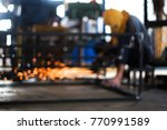 bokeh of worker whose welding... | Shutterstock . vector #770991589