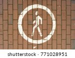 Pedestrian zone sign on a paved path