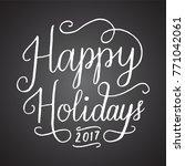 chalkboard happy holidays 2017... | Shutterstock .eps vector #771042061
