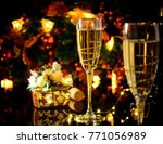 two glasses of champagne over... | Shutterstock . vector #771056989