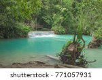 waterfall in a jungle in laos | Shutterstock . vector #771057931