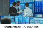 three experienced stock traders ... | Shutterstock . vector #771064405