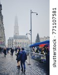 Small photo of ARRAS, FRANCE - DECEMBER 8, 2017: People do some shopping on a cold and foggy street of Arras before Christmas holidays.