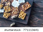 slices of turron on the wooden... | Shutterstock . vector #771113641