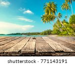 wood table with blurred sea and ... | Shutterstock . vector #771143191