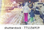 woman with a child on a snowy... | Shutterstock . vector #771156919