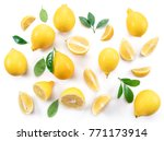 Ripe Lemons And Lemon Leaves O...
