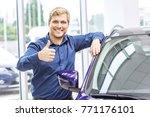 cheerful man smiling joyfully... | Shutterstock . vector #771176101