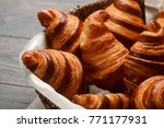 french croissants in wicker...   Shutterstock . vector #771177931