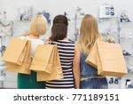 rearview shot of three women...   Shutterstock . vector #771189151