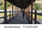 covered bridge with man walking.... | Shutterstock . vector #771191329