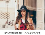 young woman in a hurry going to ... | Shutterstock . vector #771199795