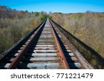 Railroad Tracks Leading Into...