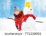 little boy in red winter... | Shutterstock . vector #771228001