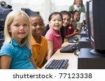 children at computer terminals... | Shutterstock . vector #77123338