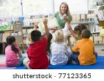 students in class volunteering... | Shutterstock . vector #77123365