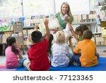 students in class volunteering... | Shutterstock . vector #77123365