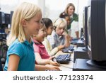 children at computer terminals... | Shutterstock . vector #77123374