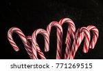candy canes on black background | Shutterstock . vector #771269515