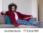 young handsome man in bathrobe... | Shutterstock . vector #771316789