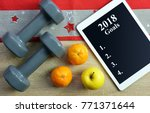 dumbbells with fruits and... | Shutterstock . vector #771371644