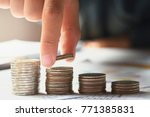 female hand stack coins to show ... | Shutterstock . vector #771385831