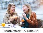 portrait of two young women... | Shutterstock . vector #771386314