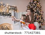 mother and daughter sitting in...   Shutterstock . vector #771427381