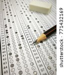 Small photo of Standard test form or school answer sheet with answers bubbled in with pencil and eraser, focus on answer sheet