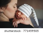 mother with newborn baby on... | Shutterstock . vector #771459505