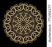 hand drawn gold mandala on a... | Shutterstock . vector #771502177