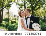groom hugging his laughing... | Shutterstock . vector #771503761