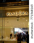 Small photo of Rome, Italy - August 11, 2017: Pandora shop. Pandora is a Danish jewelry manufacturer and retailer founded in 1982 known for its customizable charm bracelets, designer rings, necklaces and watch