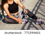 beautiful sport fitness girl in ... | Shutterstock . vector #771594601