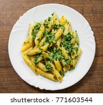 penne pasta with pesto sauce in ... | Shutterstock . vector #771603544
