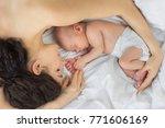 the newborn sleeps with the... | Shutterstock . vector #771606169