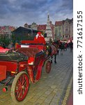 Small photo of WROCLAW, POLAND – DECEMBER 3, 2017: A red carriage pulled by horses as an attraction at the Christmas market in Old Town in Wroclaw of Advent Sunday.