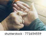 Small photo of Witch or fortune teller reading fortune lines on male palm or hand, mystic esoteric or medium paranormal chiromancy or palmistry concept, toned