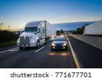 18 wheeler semi truck at night... | Shutterstock . vector #771677701