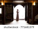 muslim woman in a doorway   Shutterstock . vector #771681379