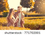 young couple walk in the autumn ... | Shutterstock . vector #771702001