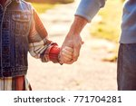 grandfather and grandson... | Shutterstock . vector #771704281