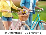 couple riding bicycle together... | Shutterstock . vector #771704941