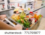 man buying food products in the ... | Shutterstock . vector #771705877