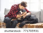 young person with dog at home... | Shutterstock . vector #771705931