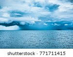 rain cloud over the sea. ... | Shutterstock . vector #771711415