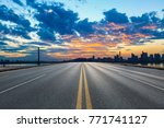empty asphalt road and city... | Shutterstock . vector #771741127